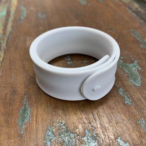 Close up image of a white Twistii SnapBand