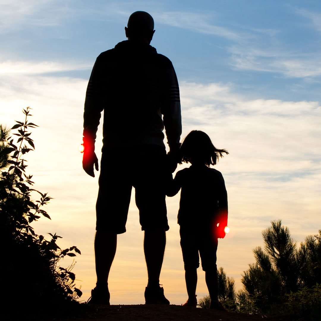Father and daughter out walking wearing their bright LED Twistii